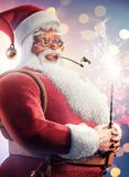 Santa Clause holding sparkler Christmas background royalty free stock photography