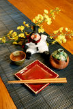 Santa Clause Japanese Style. Toy Santa with Japanese Sake set Royalty Free Stock Photography