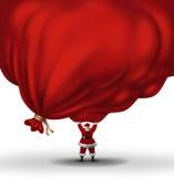 Santa Clause Lifting A Huge Bag Stock Photos