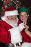 Santa Clause and a little elf Stock Photography