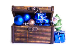 Santa Clause look in chest with presents Royalty Free Stock Photo