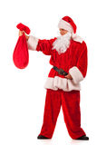 Santa Clause looking at small sack Stock Photos