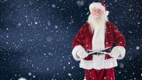 Santa clause measuring himself with a measure tape combined with falling snow. Digital composite of Santa clause measuring himself with a measure tape combined stock video