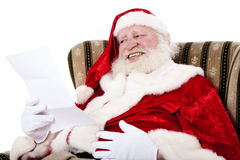 Santa Clause reading letter Royalty Free Stock Photography