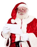 Santa Clause reading letter Royalty Free Stock Images