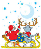 Santa Clause and Reindeer Stock Images