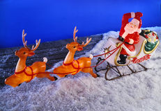 Santa clause and reindeer on roof Royalty Free Stock Photos