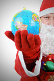Santa Clause Showing World. Christmas concept stock photo