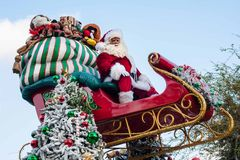 Santa Clause sits atop his sleigh in the Disneyland Parade Stock Photos