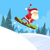 Santa Clause Snowboarder Sliding Down Hill Stock Images