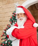 Santa Clause Standing Arms Crossed Outside House Stock Photo