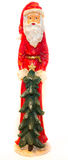 Santa Claus Statue with Christmas Tree White Background Clear. This is a beautiful sharp picture of a statue of Santa Claus with a Christmas tree Stock Images
