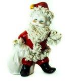 Santa Clause Statue mit dem Geschenk-weißen Hintergrund, scharf Lizenzfreies Stockfoto