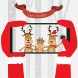 Santa Clause take the mobile photo to Reindeer family vector ill Royalty Free Stock Image
