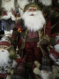 Santa clause in tartan white beard, many. Many santa clause models for sale at christmas market stock image