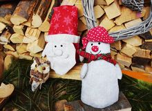 Santa Clouse toys in Dolomity mountains, winter image royalty free stock photo