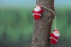 Santa Clause on the tree Stock Photos