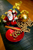 Santa Clause Vietnamese Stile. Toy Santa with lacquer   with Beads Royalty Free Stock Image