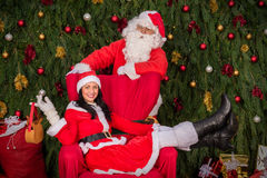 Santa Clause woman sitting on Christmas armchair Royalty Free Stock Photography
