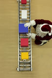 Santa clause working at conveyor belt in presents  Royalty Free Stock Photos