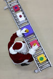 Santa clause working at production line in present Stock Photography