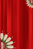 Santa Clauses. Santa Claus against photoshop generated red curtain Royalty Free Stock Image