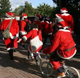 Santa Clauses on bicycles Stock Photography