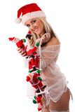 Santa Clauses clamber up sexy santa girl Royalty Free Stock Photography