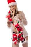 Santa Clauses clamber up santa girl stock photography