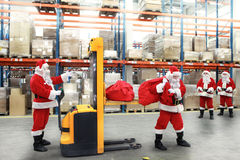 Santa Clauses In The Line For The Sacks Of Gifts Stock Photo