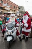 Santa Clauses on a motor scooter ride among the participants and visitors of the annual race `Cristmas Run` in Mi`ilya in Israel Stock Photos