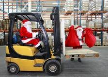 Santa clauses preparing for Christmas Stock Image