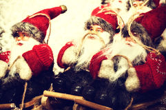 Santa Clauses on wooden sledge Stock Image