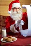 Santa Clauss-Liste stockfotografie