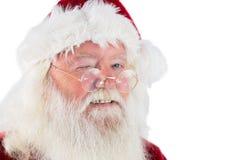 Santa cligne de l'oeil dans l'appareil-photo Photographie stock