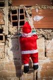 Santa climbing a grunge wall stock photo