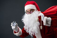Santa with clock Royalty Free Stock Photos