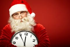 Santa with clock Royalty Free Stock Images