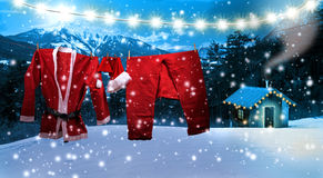 Santa clothing hanging on a clothesline Royalty Free Stock Image
