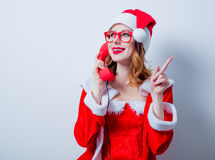 Santa Clous girl with eyeglasses and handset Stock Photography