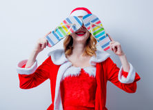 Santa Clous girl with eyeglasses and Sandales Stock Photo