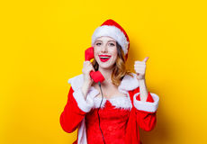 Free Santa Clous Girl In Red Clothes With Handset Stock Images - 95362904