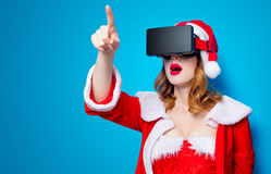 Santa Clous girl in red clothes with 3D glasses Royalty Free Stock Photography