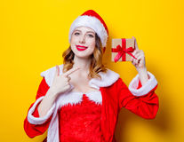 Santa Clous girl in red clothes with gift box Royalty Free Stock Photography