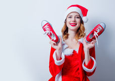 Santa Clous girl in red clothes with gumshoes Stock Photos