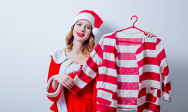 Santa Clous girl in red clothes with shirt Stock Photos