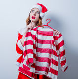 Santa Clous girl in red clothes with shirt Royalty Free Stock Photography