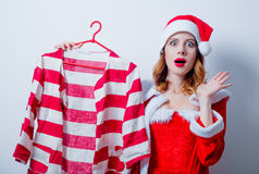 Santa Clous girl in red clothes with shirt Royalty Free Stock Images