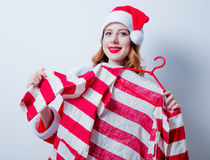 Santa Clous girl in red clothes with shirt Stock Photo