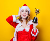 Santa Clous girl in red clothes with trophy prize Stock Images
